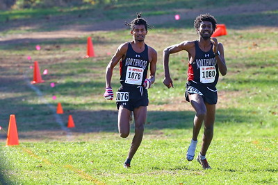 George P. Smith/The Montgomery Sentinel    Northwood High School's Obsaa Feda (15:44.05) (left) and Eldad Mulugeta(15:44.29) sprinting for the tape to finish 1st and 2nd in the 4A Boys Division of the Maryland State Public School's Cross Country Championship held at Hereford High School on Saturday, November 10, 2018. Mulugeta (1080) ran a considerable portion of the course with only one shoe.