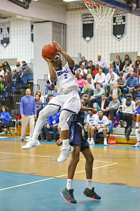 George P. Smith/The Montgomery Sentinel    Blake's TJ Sawo (2) gets his feet swept out from under him by Springbrook's Timitrius Whitney-Hawkins (3)  as he focuses on the rim.