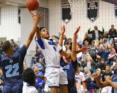 George P. Smith/The Montgomery Sentinel    Blake's Dorian Hurd (4) goes for the put back as Springbrook's Timothy Royal (22) and Justin Cook (21).
