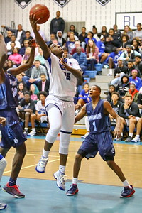 George P. Smith/The Montgomery Sentinel    Blake's Romelle Williams (15) with the hook shot past Springbrook's Daouda Dembele (34) and Amare Curtis (1).