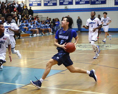 George P. Smith/The Montgomery Sentinel    Springbrook's Marcus Davis (5) taking it to the hoop.