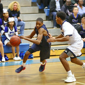 George P. Smith/The Montgomery Sentinel    Springbrook's Amare Curtis (1) drives the baseline as Blake's David Hill (11) tries to defend.