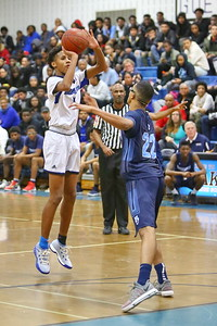 George P. Smith/The Montgomery Sentinel    Blake's Dorian Hurd (4) shoot beyond the 3 pt line over Springbrook's Timothy Royal (22).
