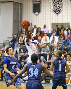 George P. Smith/The Montgomery Sentinel    Blake's Miles Samuels (1) takes it to the hoop in the midst of Springbrook players Marcus Davis (5), Daouda Dembele (34), and Amare Curtis (1).