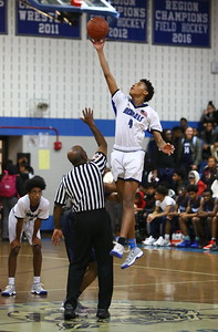 George P. Smith/The Montgomery Sentinel    Blake's Dorian Hurd (4) goes up alone at the tip off as Springbrook's Timothy Royal (22) was late getting off the ground.
