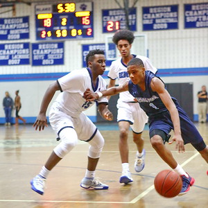 George P. Smith/The Montgomery Sentinel    Springbrook's Amare Curtis (1) driving to the basket past Blake's Romelle Williams (15).