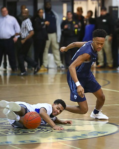 George P. Smith/The Montgomery Sentinel    Blake's David Hill (11) and Springbrook's Jonathan Lapierre (15) go after a loose ball.