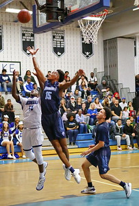 George P. Smith/The Montgomery Sentinel    Springbrook's Jonathan Lapierre (15) looks to snag a moster rebound over Blake's Romelle Williams (15).