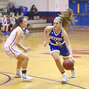 George P. Smith/The Montgomery Sentinel    Sherwood's Caroline Bidwick (2) drives the lane past Wootton's Caitlyn Kwan (4).