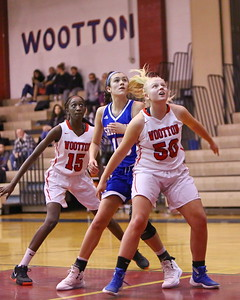 George P. Smith/The Montgomery Sentinel    Wootton's Sere Doumbouya (15 and Mary Quackenbush (50) box out Sherwood's Maddie Tringone (15) during a free throw.