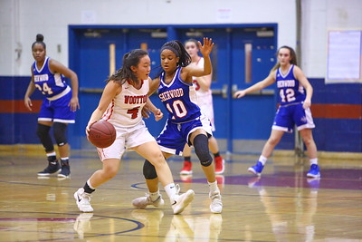 George P. Smith/The Montgomery Sentinel    Sherwood's Angela Nnabue (10) defends Wootton's Caitlyn Kwan (4) on the perimeter.