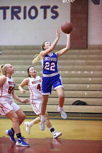 George P. Smith/The Montgomery Sentinel    Sherwood's Hanah St. Laurent (22) beats Wootton's Mary Quackenbush (50) and Caitlyn Kwan (4) to the hoop.