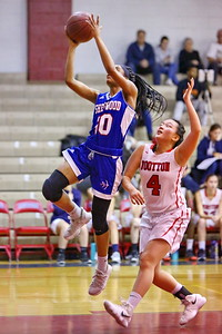 George P. Smith/The Montgomery Sentinel    Sherwood's Angela Nnabue (10) taking it to the hoop as Wootton's Caitlyn Kwan (4) tries to defend.