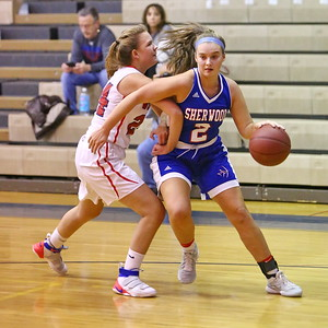 George P. Smith/The Montgomery Sentinel    Sherwood's Caroline Bidwick (2) turns the corner past Wootton's Samantha Keller (24).