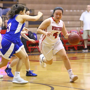 George P. Smith/The Montgomery Sentinel    Wootton's Caitlyn Kwan (4) works the perimeter against Sherwood.