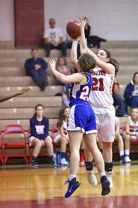 George P. Smith/The Montgomery Sentinel    Wootton's Crystal Bridge (21) shoots over Sherwood's Julia Brody (25).