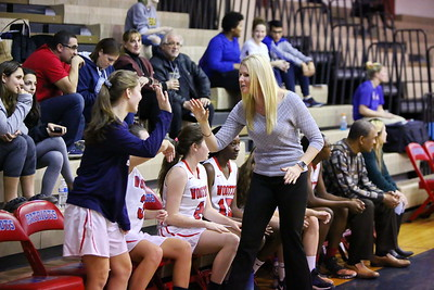 George P. Smith/The Montgomery Sentinel    Wootton players get high fives from Coach Maggie McDermott Dyer.