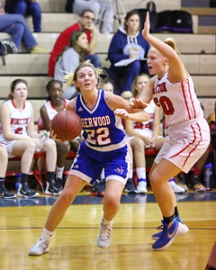 George P. Smith/The Montgomery Sentinel    Sherwood's Hannah St. Laurent (22) works the baseline against Wootton's Mary Quackenbush (50).