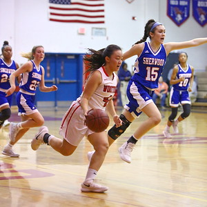 George P. Smith/The Montgomery Sentinel    Wootton's Caitlyn Kwan (4) driving downcourt as Sherwood's Maddie Tringone (15) points out an assignment.
