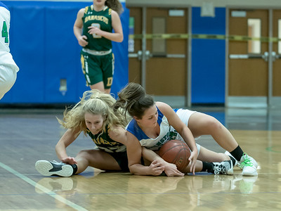 Kaitlyn Desmond of Damascus and Katie Stanish of Churchill battle for a loose ball. PHOTO BY MIKE CLARK