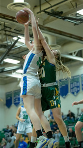 Parker Hill (33) of Churchill boxes out Kathryn Lanham of Damascus for the rebound. PHOTO BY MIKE CLARK