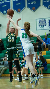 Churchill's Parker Hill (33) uses her height and reach advantage to block this shot attempt by Damascus' Claire Bradshaw. PHOTO BY MIKE CLARK