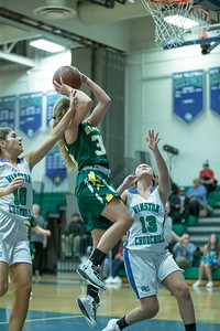 Kaitlyn Desmond of Damascus drives and draws the foul by Churchill's Leah Rubino. PHOTO BY MIKE CLARK