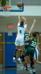 Brittini Martin (4) of Churchill elevates for two of her seven points in the 50-33 win over Damascus. PHOTO BY MIKE CLARK