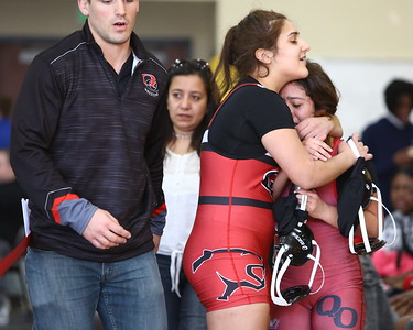 George P. Smith/The Montgomery Sentinel    Quince Orchard's Sarah Mesri comforts teammate Rebecca Soto after Soto lost her championship match in the 106 lb weight class to Henry E. Lackey's Savannah McBain in an 11-5 decision.