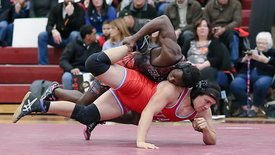 Blair's Brandon Ntankeu chases down Einstein's Issac Hernandez. Ntankeu gets the fall at 4:27 in the 182-pound weight class. PHOTO BY MIKE CLARK
