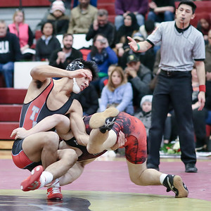 Nikolai Tochilin of Blair and Allan Vasquez of Einstein go at it in the 126-pound weight class. Tochilin takes the match. PHOTO BY MIKE CLARK