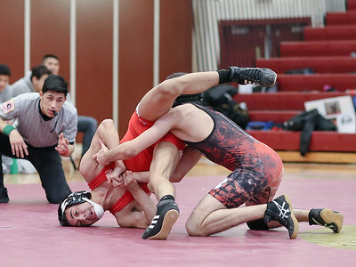 Muhammad Baig of Blair takes down Franklin Cortez of Einstein for the win in the 120-pound weight class. PHOTO BY MIKE CLARK
