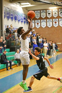 George P. Smith/The Montgomery Sentinel    Churchill's TJ Richardson (4)  shooting the 3 over Whitman's Jaden Pierce (12).