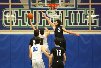 George P. Smith/The Montgomery Sentinel    Whitman's Brendan Shaver (3) blocks the shot by Churchill's Michael Janis (2).