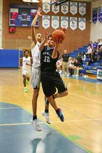 George P. Smith/The Montgomery Sentinel    Whitman's Jaden Pierce (12) taking it to the hoop past Churchill's Jomo Goings.