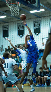 Sherwood's Terrill Simms Jr. drops in this layup for two of his game-high twleve points against Blake. PHOTO BY MIKE CLARK