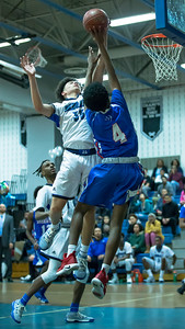 Blake's David Hill rejects this shot attempt by Sherwood's  Noah Elias. PHOTO BY MIKE CLARK