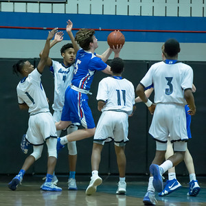 Sherwood's Dominico Martella weaves through the Blake defense to drop in two of his 11 points. PHOTO BY MIKE CLARK