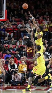 Maryland's Bruno Fernando (23) fires over  Minnesota's Daniel Oturo (25) for two of his 11 points that helped the Terps win 69-60. PHOTO BY MIKE CLARK
