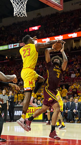 Bruno Fernando (23) of Maryland blocks the shot attempt by Minnesota's Jordan Murphy (3). Fernando ended with 11 points and 11 rebounds. PHOTO BY MIKE CLARK
