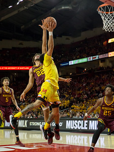 Maryland's Anthony Cowan Jr. proved too fast for the Minnesota defense, here blowing past Gabe Kalscheur (22) for two of his 21 points. PHOTO BY MIKE CLARK