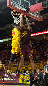 Maryland's Jalen Smith (25) ruled the paint by rejected three shots, including this effort by Minnesota's Jordan Murphy (3). Maryland's defense held the Golden Gophers to only 38% shooting. PHOTO BY MIKE CLARK