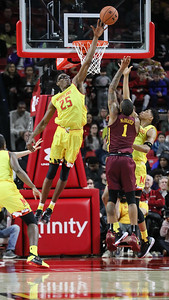 Jalen Smith (25) of Maryland picks up one of his three blocks against Minnesota, this time rejecting Dupree McBraver (1). PHOTO BY MIKE CLARK
