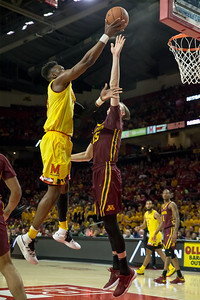 Maryland's Bruno Fernando (23) skies over Minnesota's Matz Stockman for a layup. PHOTO BY MIKE CLARK