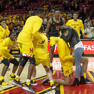 Ivan Bender surprises his girl friend, Andrea Knezevic, with a mid-court marriage proposal during Maryland's Senior Night celebration. PHOTO BY MIKE CLARK
