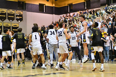 The Richard Montgomery team storms the floor after winning the quarter final championship over Walter Johnson High School.  Boys Basketball Walter Johnson at Richard Montgomery.  4A Qtr. finals  Photo Credit:  David Wolfe