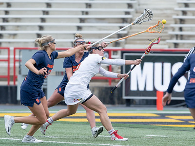 Maryland's Jen Giles splits the Syracuse defenders and scores one of her three goals on the day. PHOTO BY MIKE CLARK
