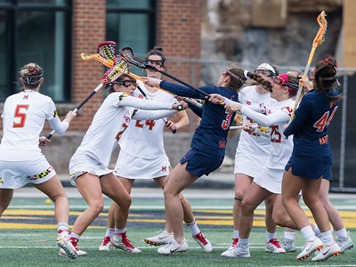 Maryland's defense collapses on Syracuse's Sam Swart (3) and breaks up Swart shot attempt. PHOTO BY MIKE CLARK