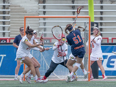 Maryland Goalie Megan Taylor (34) was outstanding in goal with 11 saves, including four critical saves in the closing minutes of regulation and overtime. PHOTO BY MIKE CLARK