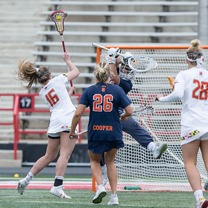 Kali Hartshorn (16) of Maryland scores the game winning shot against Syracuse to keep the Terps underfeated. PHOTO BY MIKE CLARK